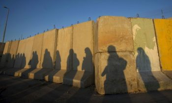 Shadows of Palestinian women are seen at Qalandiya checkpoint outside the West Bank city of Ramallah August 28, 2009, as they try to reach the al-Aqsa mosque in Jerusalem on the first Friday of the Muslim holy month of Ramadan. Muslims around the world abstain from eating, drinking and sexual relations from sunrise to sunset during Ramadan, the holiest month in the Islamic calendar.  REUTERS/Fadi Arouri (WEST BANK RELIGION IMAGES OF THE DAY SOCIETY) - GM1E58S1BBS01